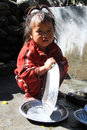 Young girl jagat nepal circa october wash dishes Royalty Free Stock Photography