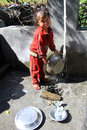 Young girl jagat nepal circa october wash dishes Stock Photos