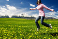 Young girl jumping on a meadow Royalty Free Stock Images