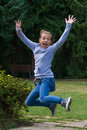 Young girl jumping to express joy Royalty Free Stock Photo