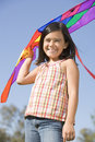 Young girl with kite outdoors smiling Royalty Free Stock Photo