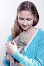 Young girl with a kitten Stock Image