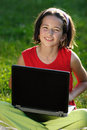 Young girl with laptop Royalty Free Stock Images