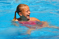 Young Girl Laughs in Swimming Pool Royalty Free Stock Photo