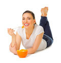 Young girl laying on the floor with fruit salad Royalty Free Stock Photo