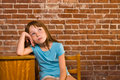 Young girl leaning old school desk brick building thinking school year to start Royalty Free Stock Photo