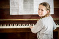 Young girl learning piano playing on at home Stock Photos