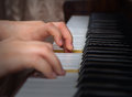 The young girl learns to play a piano hands of who Royalty Free Stock Images