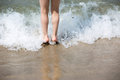 Young girl legs in sea surf Royalty Free Stock Photo