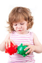 Young Girl lets her piggy banks kiss each other Royalty Free Stock Photo