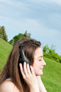 Young girl listens to music with headphones. Royalty Free Stock Photo