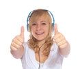 Young girl listens to music with headphones Stock Photo