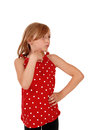 Young girl looking away a pretty and in a red dress with her hand under her chin isolated on white background Royalty Free Stock Photos
