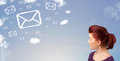 Young girl looking at mail symbol clouds on blue sky casual Royalty Free Stock Image
