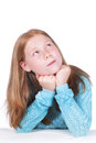 Young girl looking sideways thinking Royalty Free Stock Photos