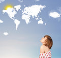 Young girl looking at world clouds and sun on blue sky casual Stock Photography