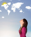 Young girl looking at world clouds and sun on blue sky casual Royalty Free Stock Images