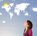 Young girl looking at world clouds and sun on blue sky Royalty Free Stock Photo