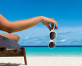Young girl lying on a beach lounger with glasses on beach Royalty Free Stock Photo