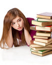 Young girl is lying on a floor with books Royalty Free Stock Images