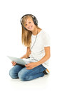 Young girl lying on the floor listening to music over white back Royalty Free Stock Photo