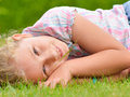 Young girl lying on the grass smilling Stock Photo