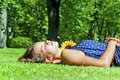 Young girl lying on green grass Royalty Free Stock Photo