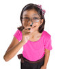 Young girl with magnifying glass v a a Stock Images