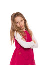 Young girl making face with long hair wearing red dress and faces isolated on white background Stock Photography