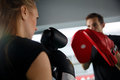 Young girl with man boxing Royalty Free Stock Photo