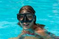 Young girl in the mask happy diving a swimming Royalty Free Stock Image