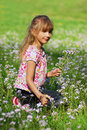 Young girl  on meadow Stock Photo