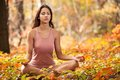 Young Girl Meditating In Autum...