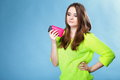 Young girl with mobile phone in pink cover Royalty Free Stock Photo