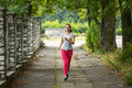 Young girl during a morning jog in the Park. Sport. Royalty Free Stock Photo