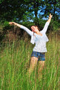 Young girl in nature beautiful on a sunny summer day enjoying life Stock Photo