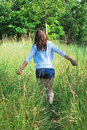 Young girl in nature beautiful on a sunny summer day walking grass Royalty Free Stock Photography