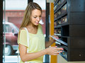 Young girl near posting box taking junk mail out the Royalty Free Stock Images