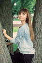 Young girl near a tree posing in the park Stock Images