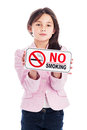 Young girl with a no smoking sign beautiful nine year old holding isolated on studio white background warning and an instruction Royalty Free Stock Photography