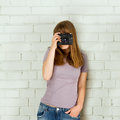 Young girl with an old vintage camera taking picture Stock Photography