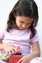 Young Girl Opening Present Royalty Free Stock Images