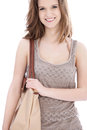 Young girl out shopping with a large cloth bag over her shoulder and a delightful smile isolated on white Stock Image