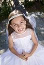 Young girl outdoors holding rosary beads Royalty Free Stock Photo