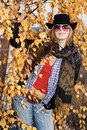 Young girl over autumnal background Royalty Free Stock Images