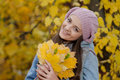 Young girl in a park in autumn with yellow leaves Royalty Free Stock Photo