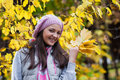 Young girl in a park in autumn with yellow leaves Royalty Free Stock Images