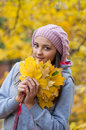 Young girl in a park in autumn with yellow leaves Stock Image