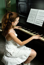 Young girl and piano at home Royalty Free Stock Photography