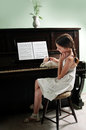 Young girl and piano at home Royalty Free Stock Images